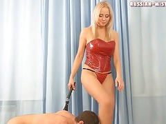 Mistress in red latex corset abuses him tubes