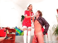 Naughty latex nurse makes him suck strapon cock tubes