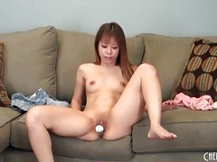 Petite girl with toys banging her pussy tubes