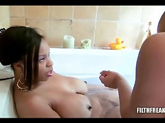 Curvy black lesbians kissing and sucking tits in bath tubes