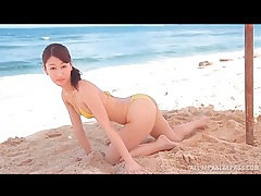 Skinny japanese hottie in bikini on the beach tubes