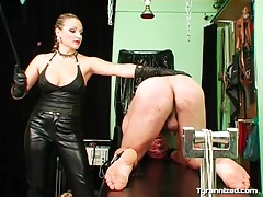 Mistress abuses his ass with her riding crop tubes