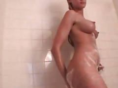 Sexy lean blonde takes a shower and shaves tubes