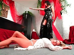 Blonde girl bound in coffin by latex mistress tubes