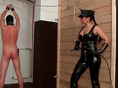Leather mistress whips him hard over the back tubes