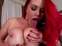 Tattooed redhead fondling her big tits solo tubes