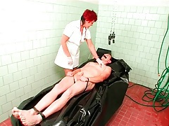 Man in body bag abused by sexy mature nurse tubes