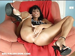 Gorgeous dark haired european babe fills her pussy with a giant dildo tubes