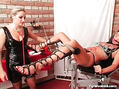 Clamps on the cunt of girl submitting to mistress tubes