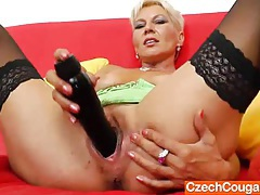 Orgasmic blonde mom playing with herself with toys tubes