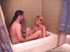 Couple films their fun in the bathtub tubes