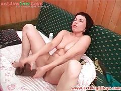 Monstrous dildo fucks brunette in her pussy tubes