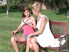 Milf rubs smooth teen pussy on park bench tubes