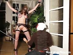 Brutally fisted busty slut in bondage tubes