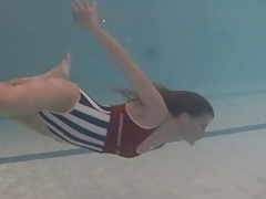 Leggy girl swims and strips naked in pool tubes