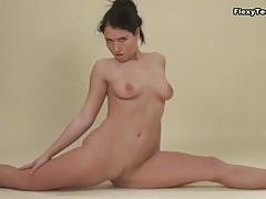 Naughty naked girl in socks does a split tubes