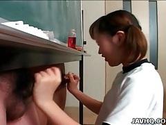 Schoolgirl strokes two dicks in classroom tubes