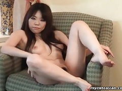 Small tits asian strips and poses for pictures tubes
