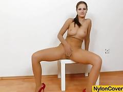 Brunette rides dildo in panty-hose tubes