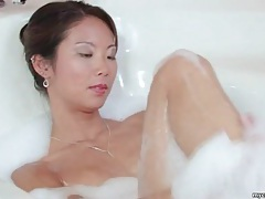 Beautiful asian masturbates in the bathtub tubes