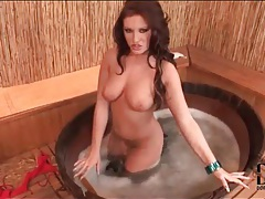 Big tits brunette looks sexy with wet body tubes