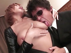 Dominant girl dressed in leather gets tits sucked tubes
