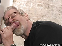 Mature guy sucks strangers cock at the gloryhole tubes