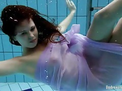 Purple dress falls off brunette in the pool tubes