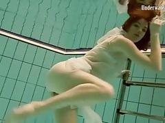 Flawless teen in sheer white lingerie swims tubes
