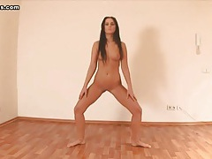 Tanned gal gets naked and shows flexibility tubes