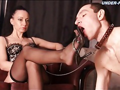 Commanding mistress in lingerie demands service tubes