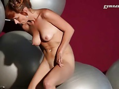 Fit body redhead bounces on exercise ball tubes
