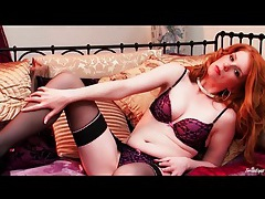 Redhead treats us to an erotic striptease tubes