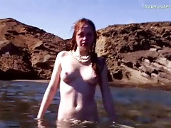 Lovely naked swim in shallow ocean water tubes