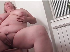Horny fat housewife naked in her kitchen tubes