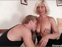 Horny mature wraps her lips around his cock tubes