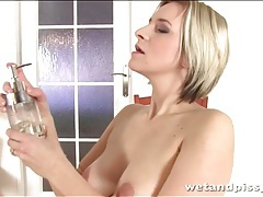 Blonde pees her panties and plays with them tubes