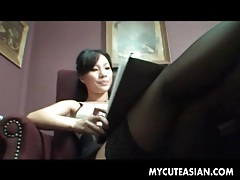 Asian secretary in short skirt and stockings tubes