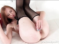 Gorgeous redhead opens cunt with speculum tubes