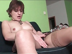 Milf in stockings sensually rubs her pussy tubes
