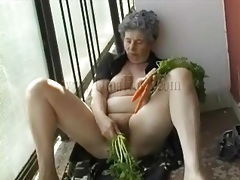 Carrots fill granny pussy in masturbation video tubes
