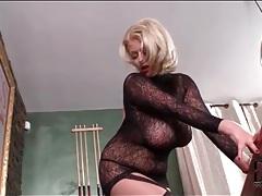 Voluptuous blonde in black lace lingerie teases tubes