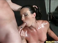Fit chick oiled up and sucking dick tubes