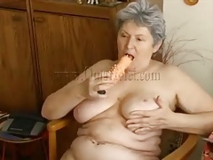 Big tits granny turns on her hole with dildo tubes
