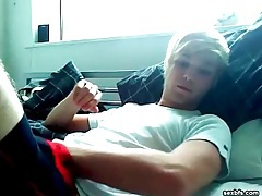 Smooth blonde boy cums on his stomach tubes