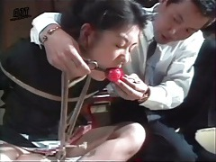 Gagged and bound girl drools in bdsm video tubes