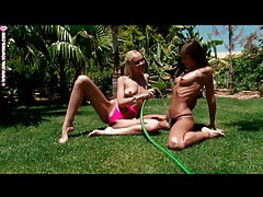 Teen lesbians get wet and sexy in the grass tubes