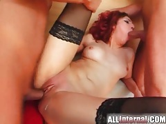 Skinny redhead rides two guys to creampie tubes