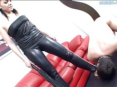 Submissive licks hot chick in leather all over tubes