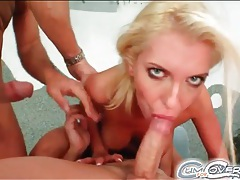 Blonde with fake tits eats cock and takes cum tubes